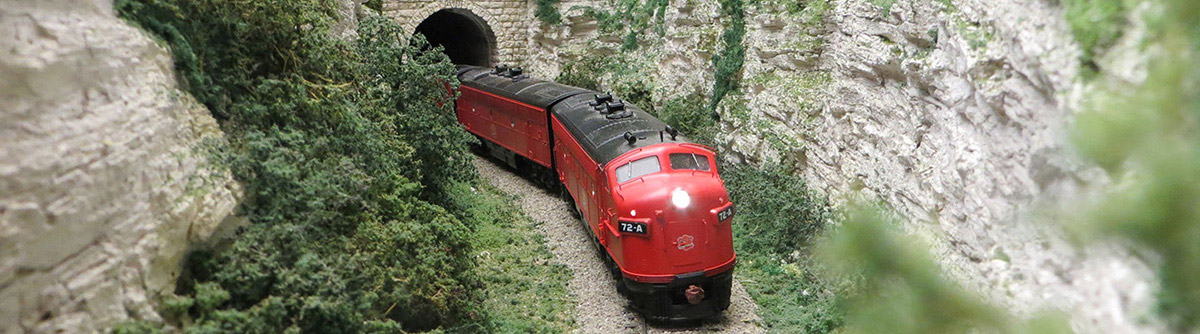 MKT locomotive emerges from tunnel on Steve Nelson's layout